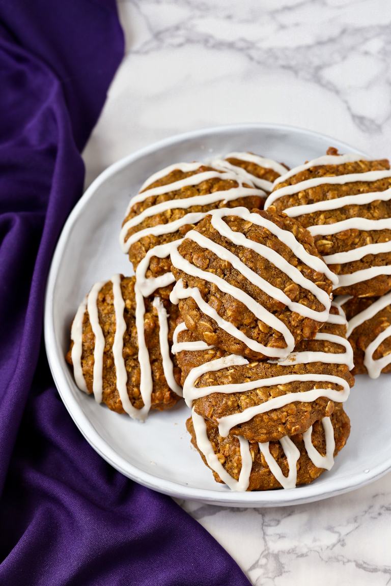 white plate of low-fat vegan iced oatmeal cookies