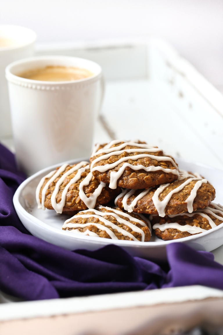 Plate of iced oatmeal cookies with coffee