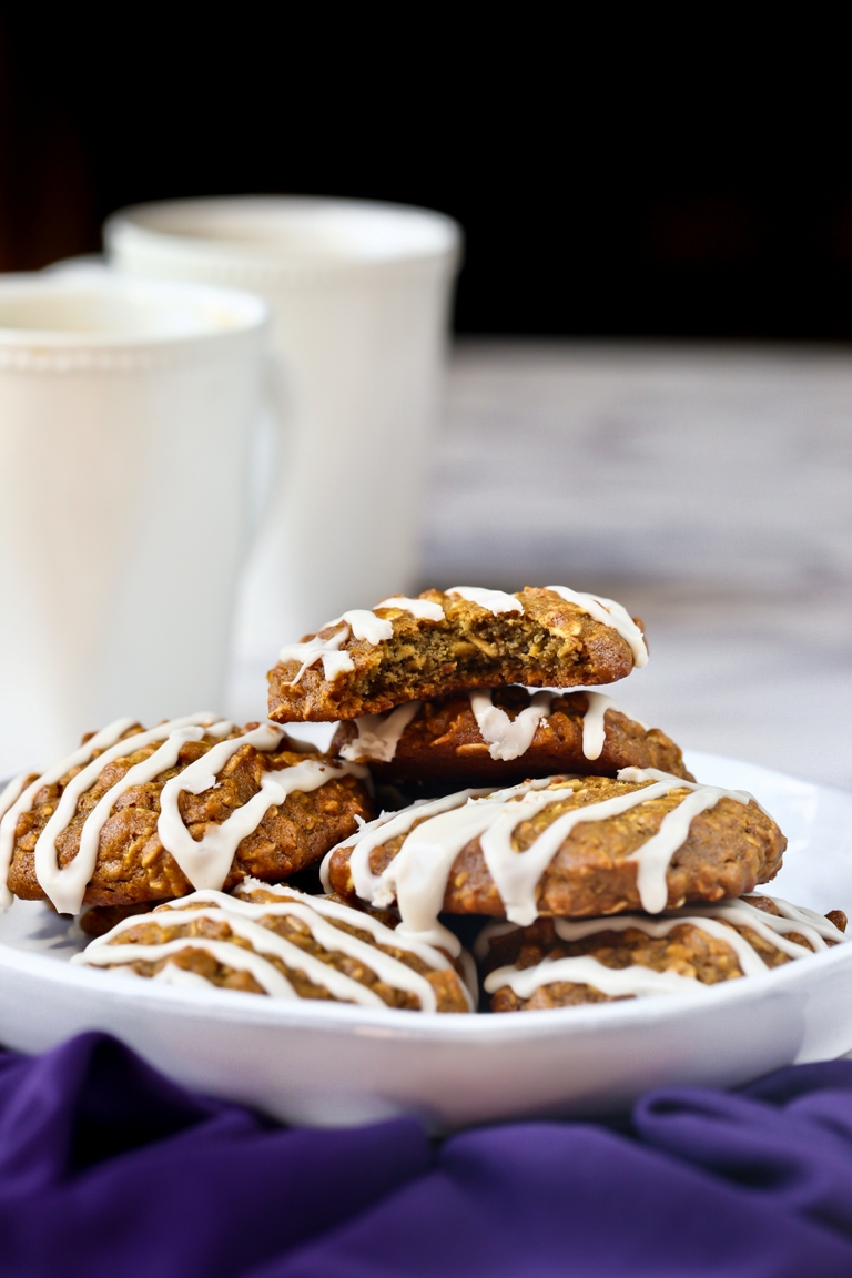 Plate of vegan iced oatmeal cookies with icing