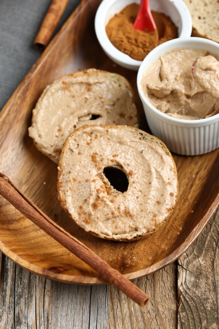 bagels of vegan apple cinnamon cream cheese on wood platter