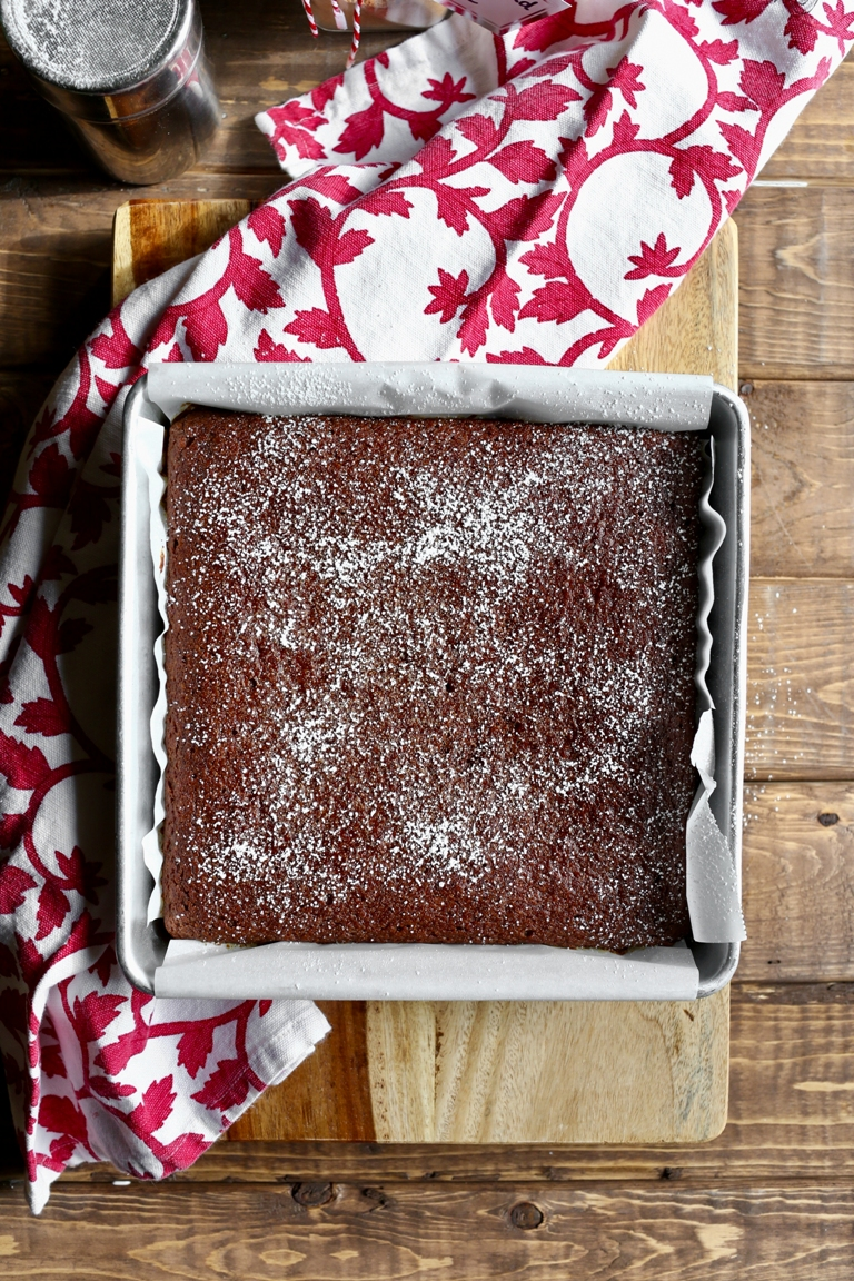 Overhead view of a just baked vegan gingerbread cake in pan