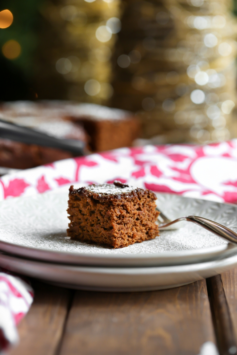 Slice of vegan gingerbread cake on a white plate