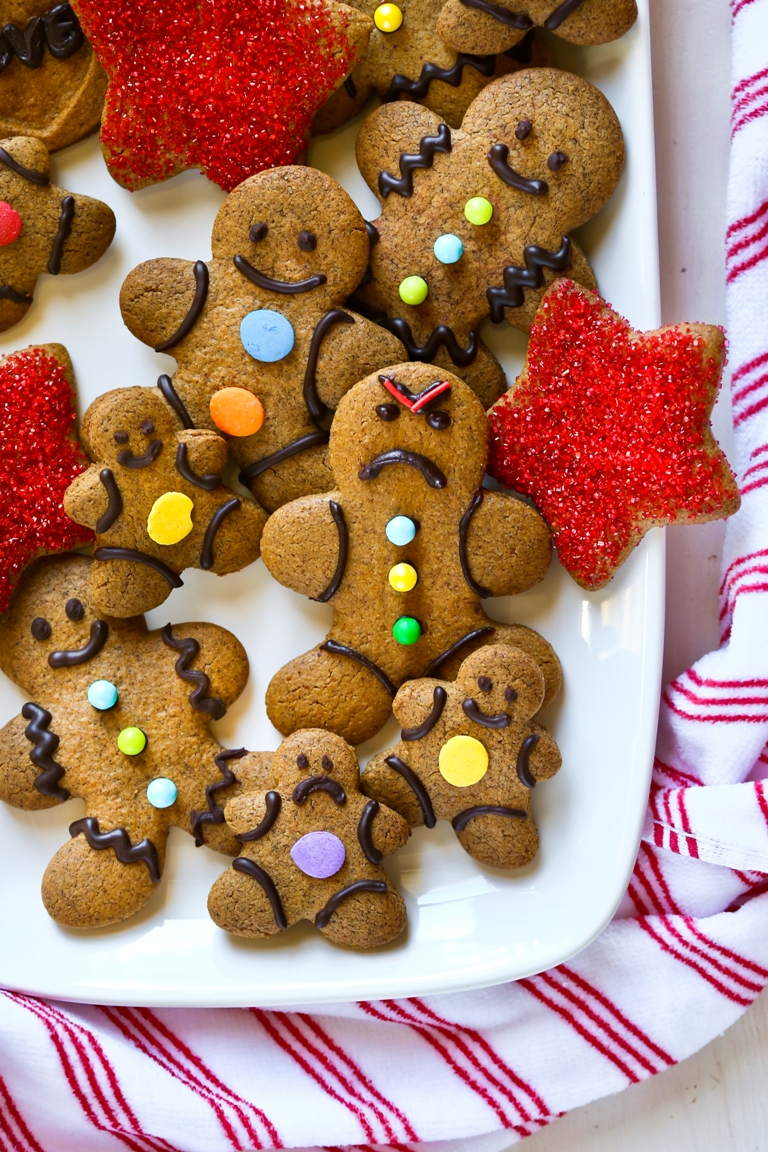 white platter of decorated vegan gingerbread men
