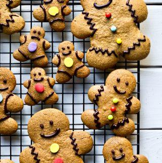 several vegan gingerbread men cookies on cooling rack