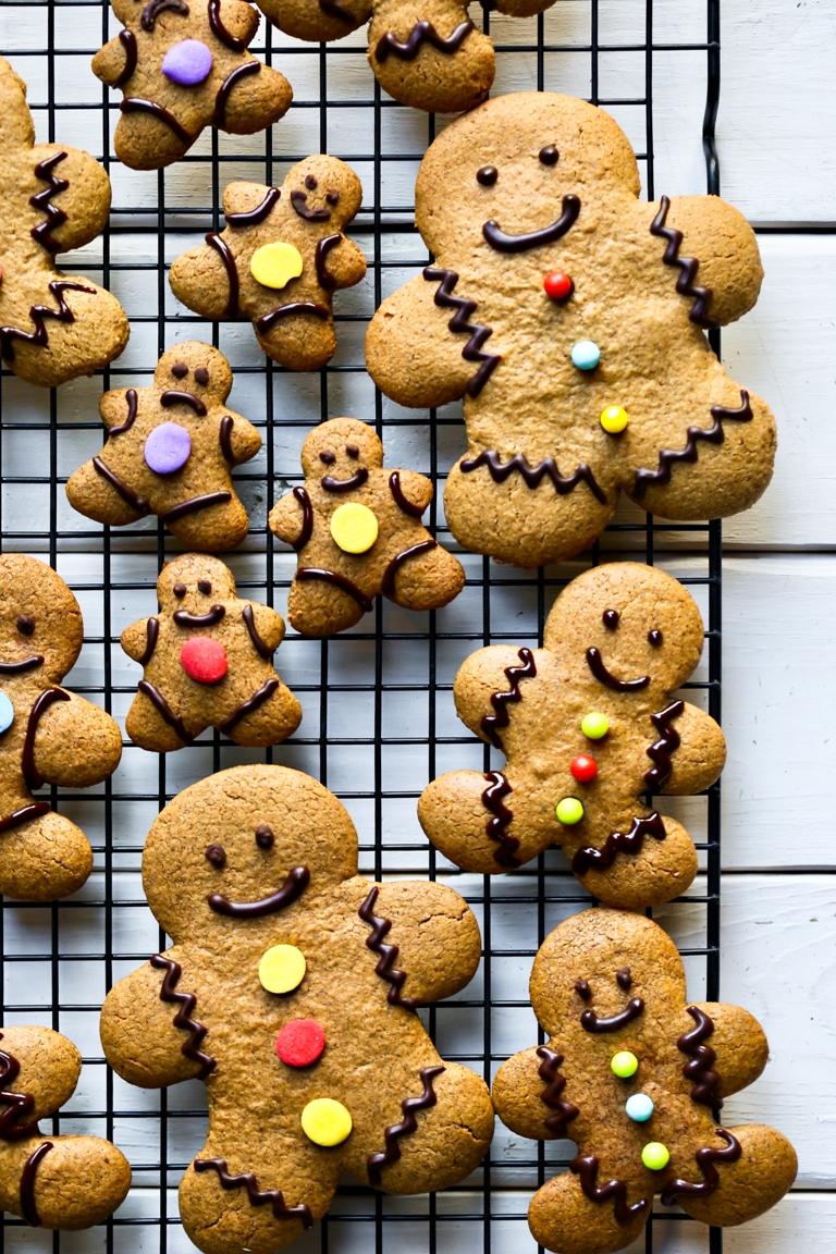 overhead shot of several gingerbread men cookies on cooling rack