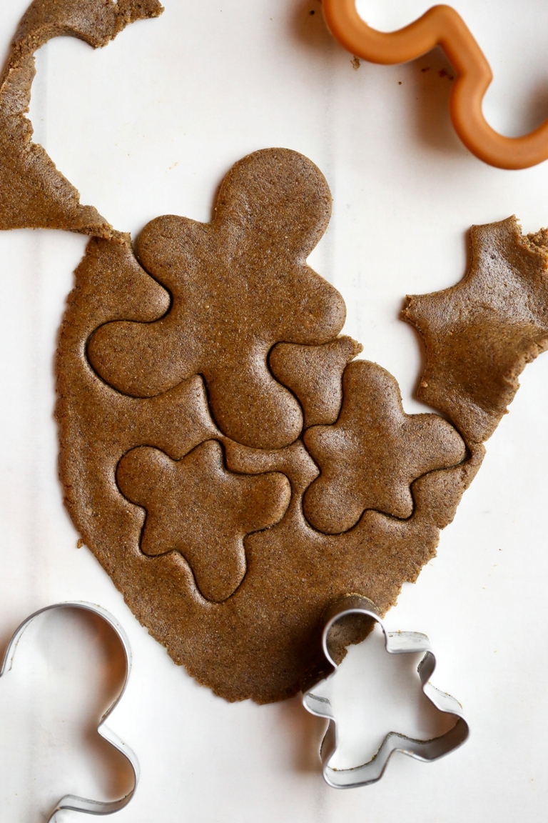 rolled out vegan gingerbread cookie dough with cookie cutters