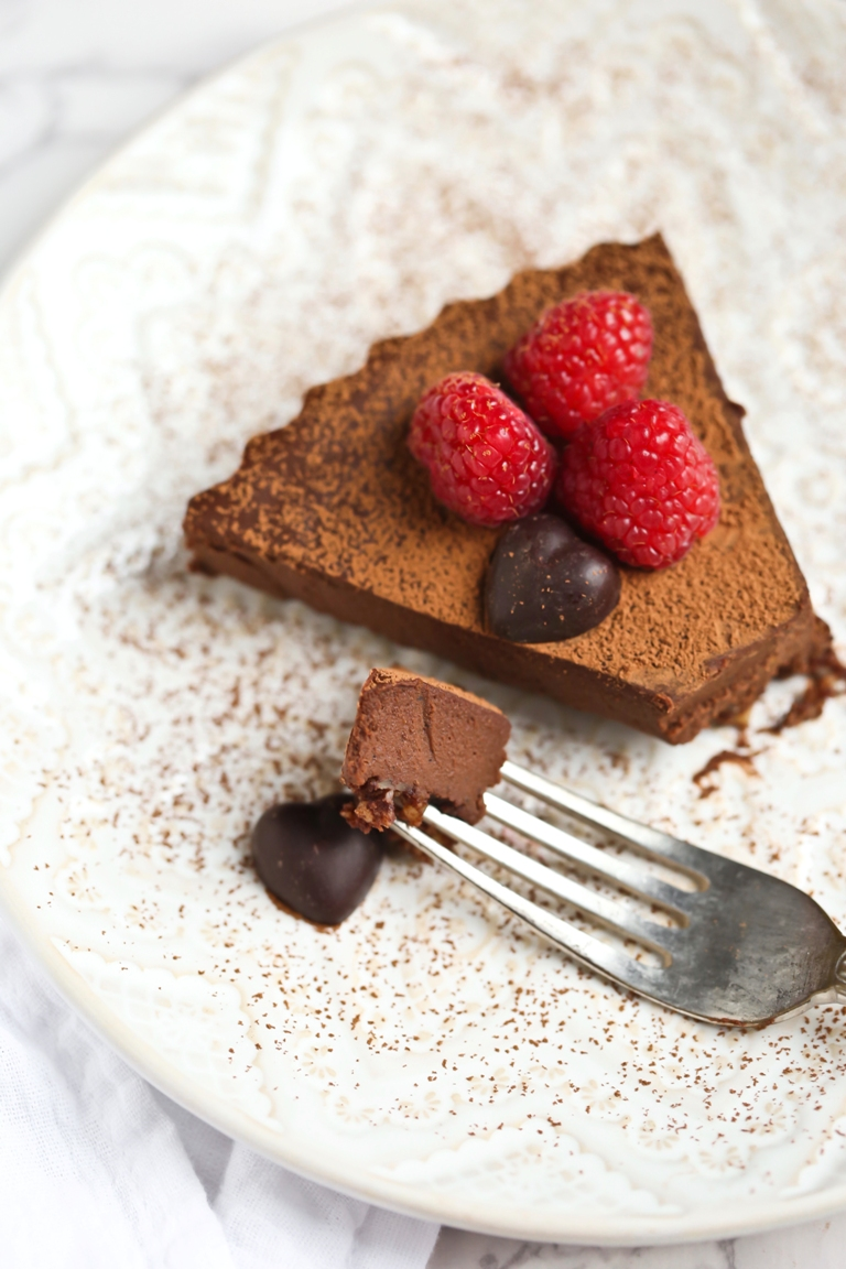 Fork holding piece of vegan chocolate sweet potato tart