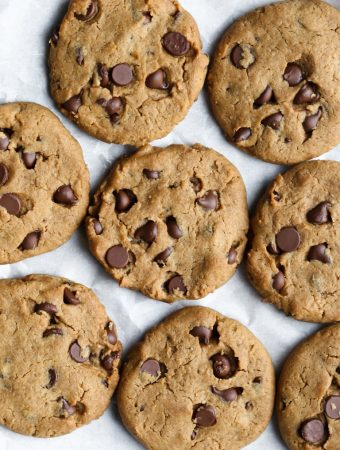 cookies spread out onto parchment paper