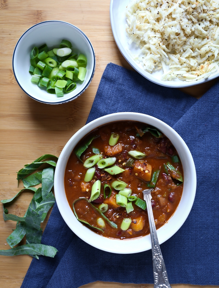 vegan curried Jamaican stew with side of green onions