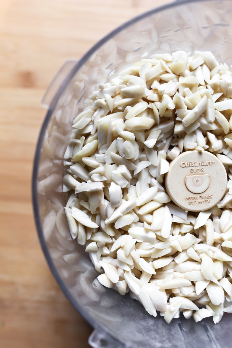 Food processor with soaked slivered almonds.
