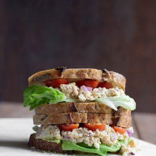 2 vegan caesar chickpea sandwiches stacked