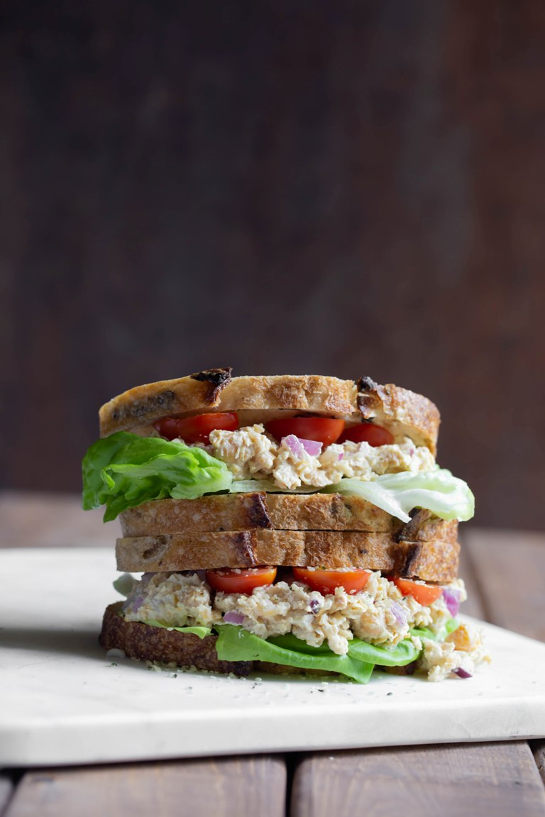 2 vegan caesar chickpea sandwiches stacked