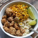 white bowl with Jamaican cauliflower corn and rice