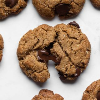 Grain-free chocolate chip cookie broken with melted chocolate