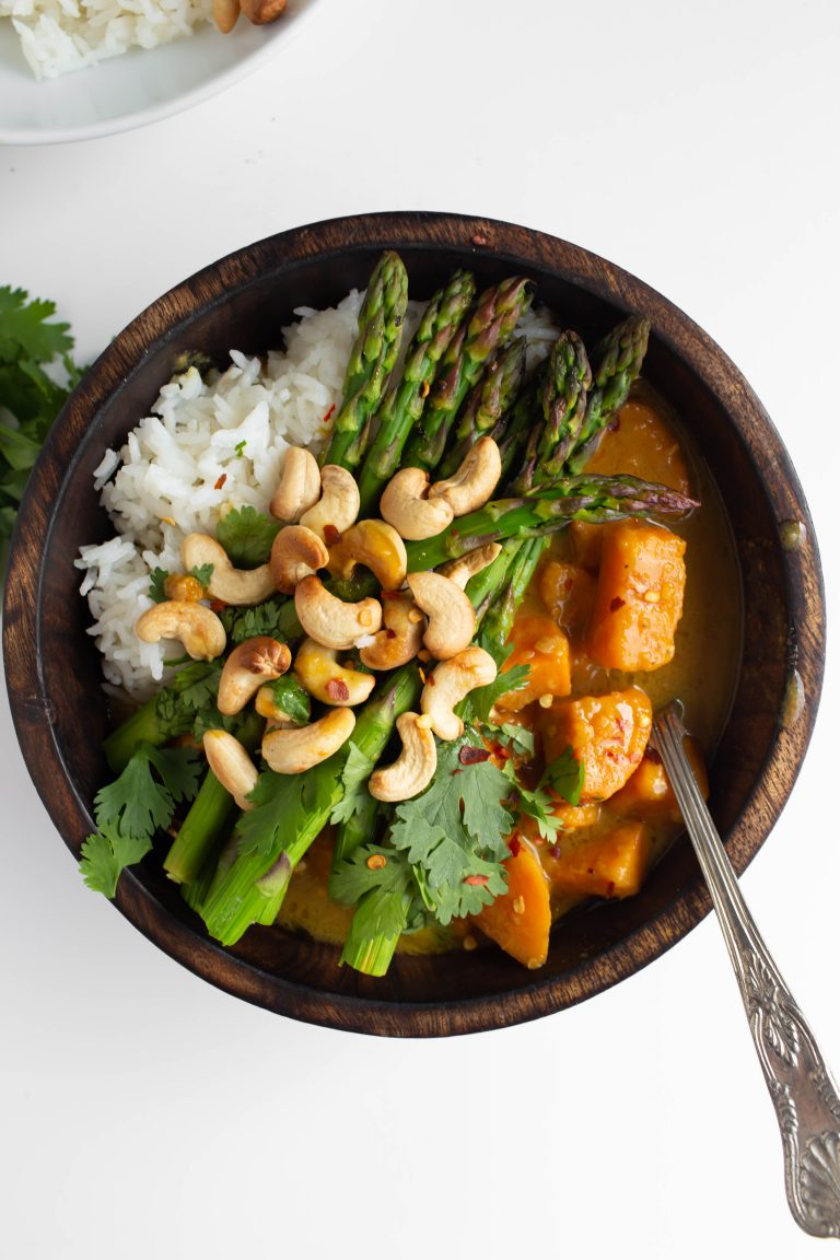 gorgeous bowl of vegan thai green sweet potato curry with cashews