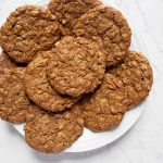 white round plate of vegan chai cookies scattered on top