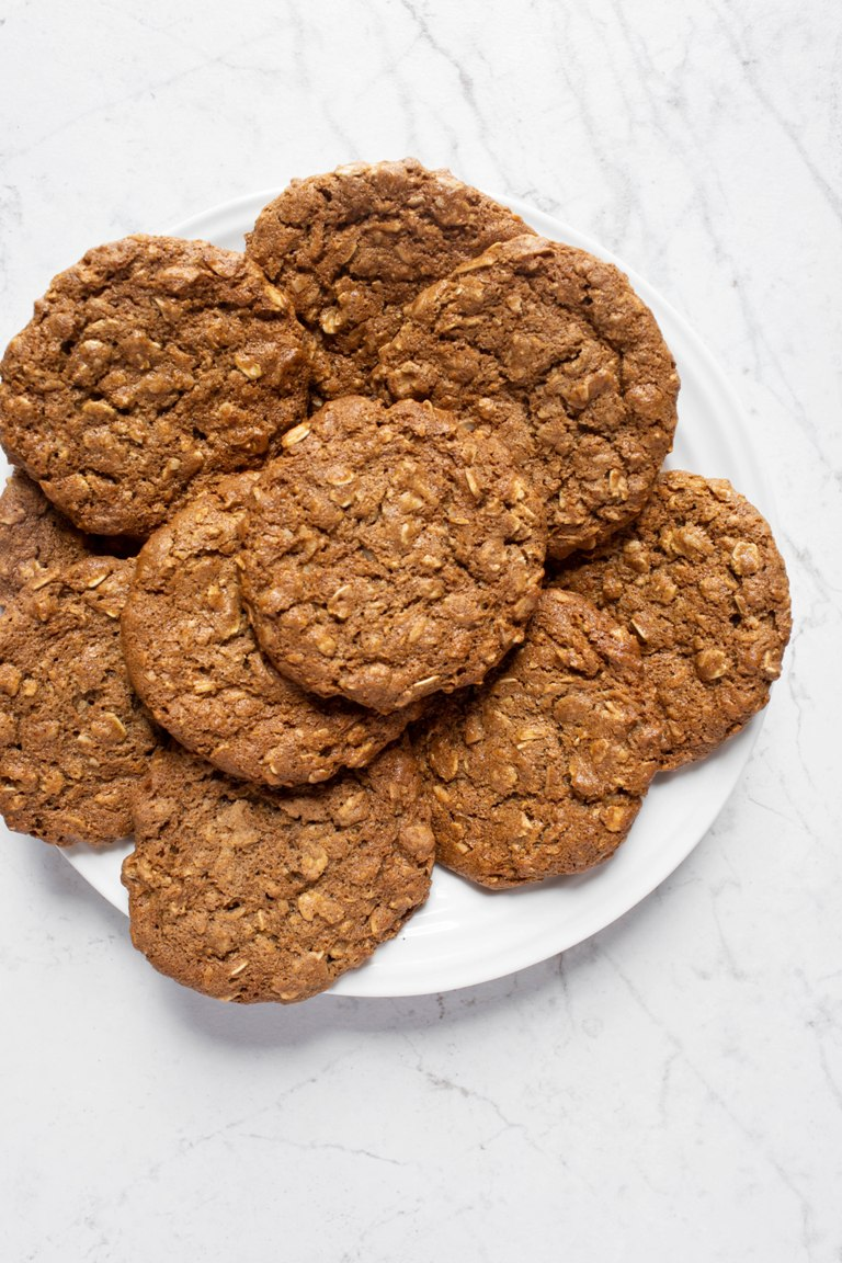 White plate of several vegan chai coconut oatmeal cookies
