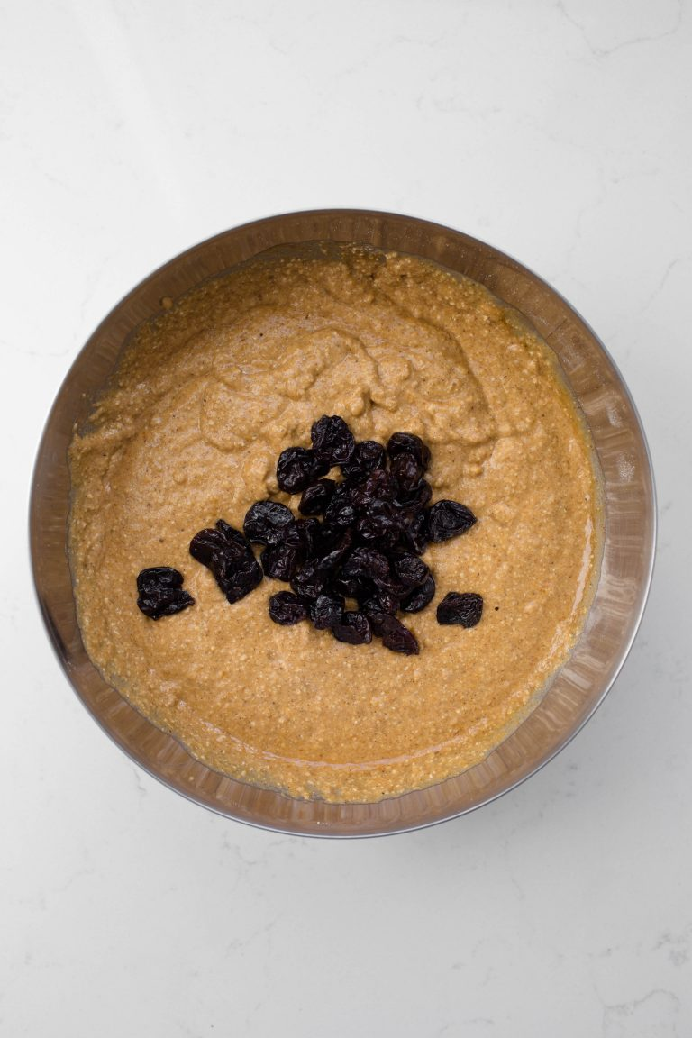 Pumpkin batter with dried cherries in bowl
