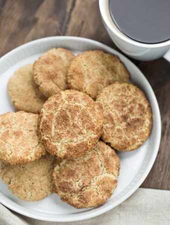 white plate of vegan snickerdoodles and coffee