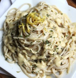 Large plate of vegan alfredo sauce over pasta.