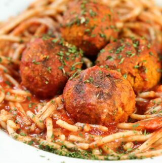 closeup of vegan meatballs on spaghetti