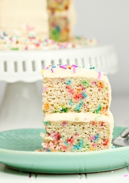 Double layer slice of vegan funfetti cake
