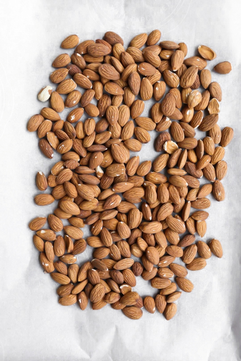 Raw almonds on parchment paper