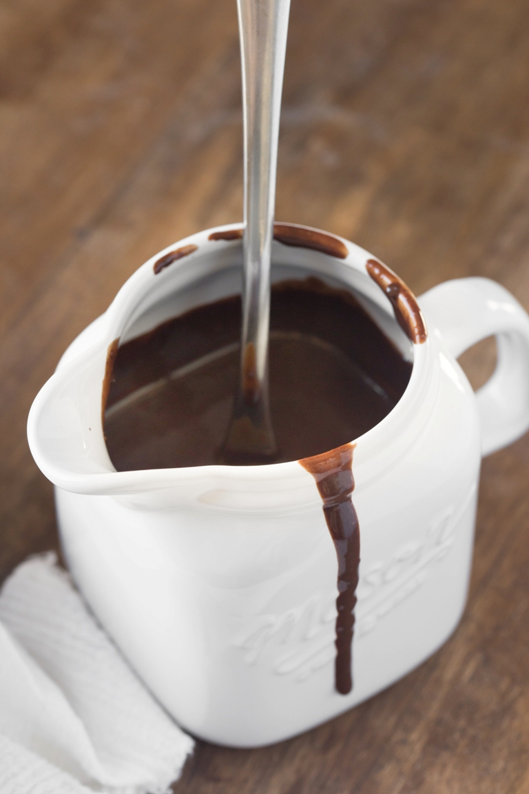 White handle jar holding vegan chocolate sauce