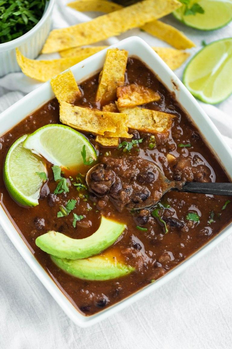 Easy Vegan Black Bean Soup with avocado in bowl