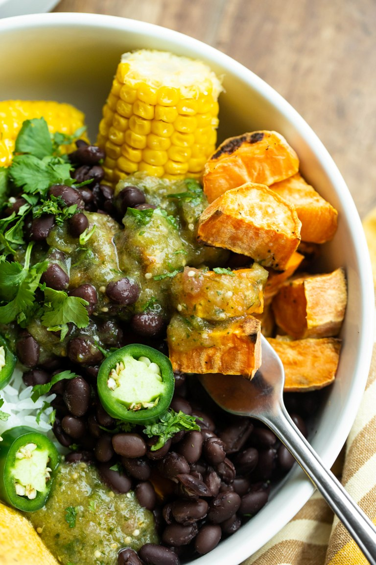 Roasted tomatillo salsa verde bowl with potatoes and corn