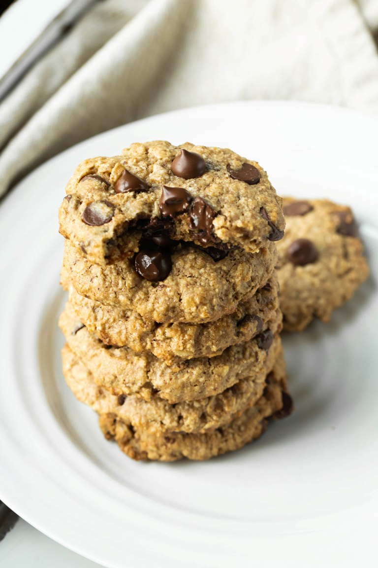 Vegan Gluten-free Oatmeal Chocolate Chip Cookies stacked on plate