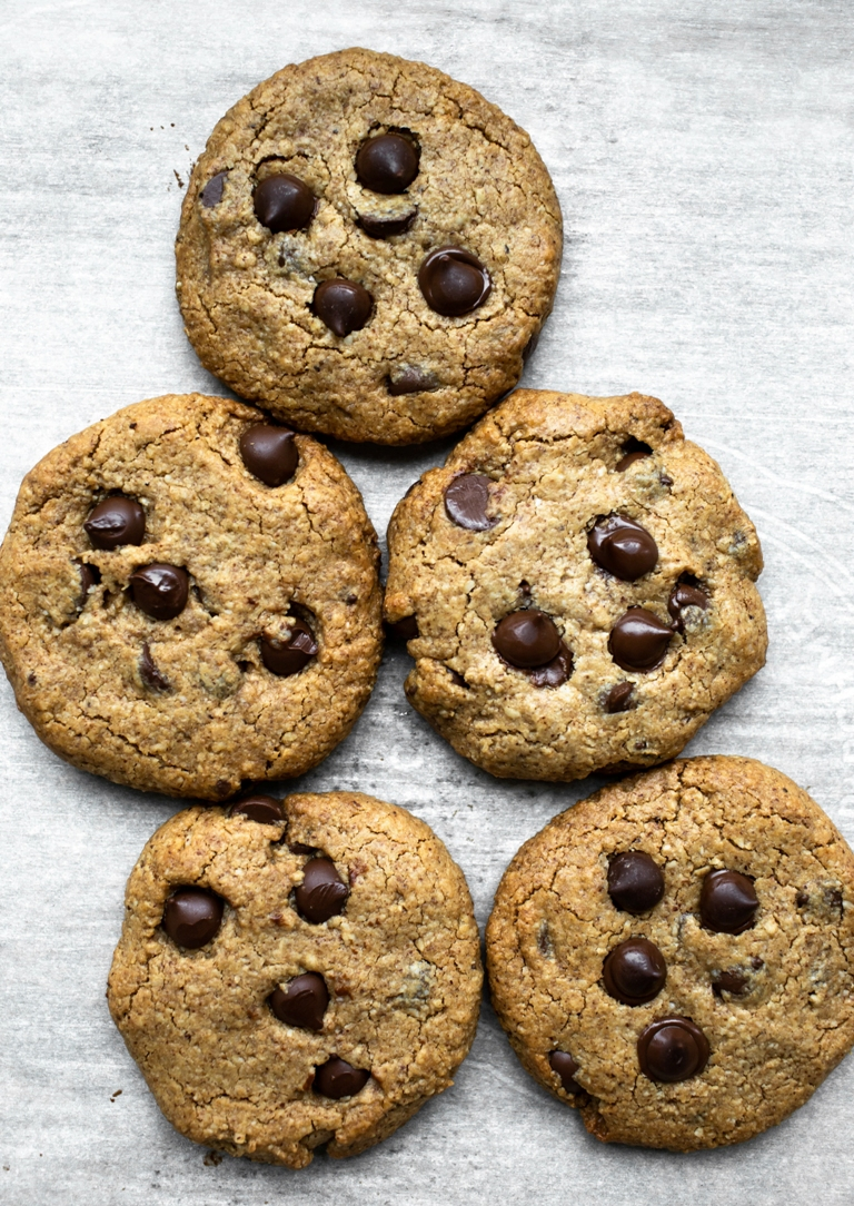Almond Butter Chocolate Chip Cookies on parchment paper