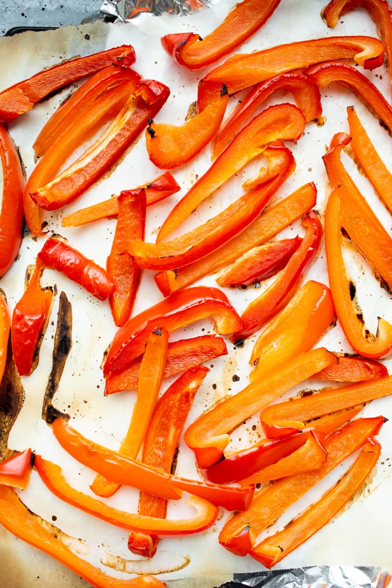 Roasted red bell pepper strips on pan