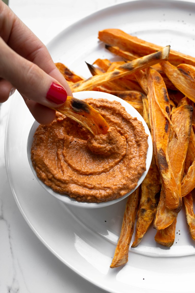 oil-free romesco sauce in bowl with fry