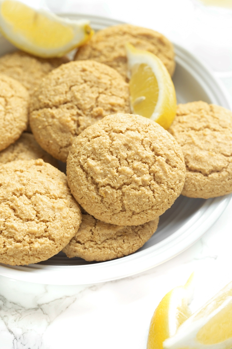 lemon cookies stacked on white round plate