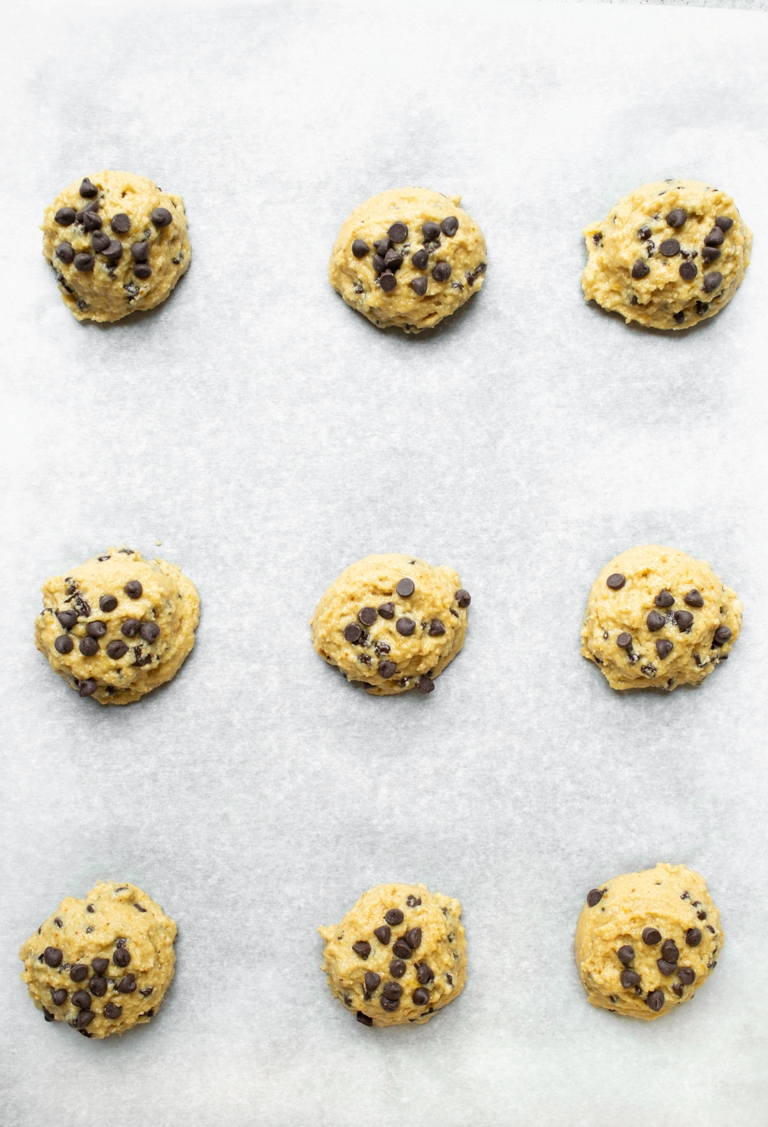 pre-baked cookie dough batter scoops onto cookie sheet