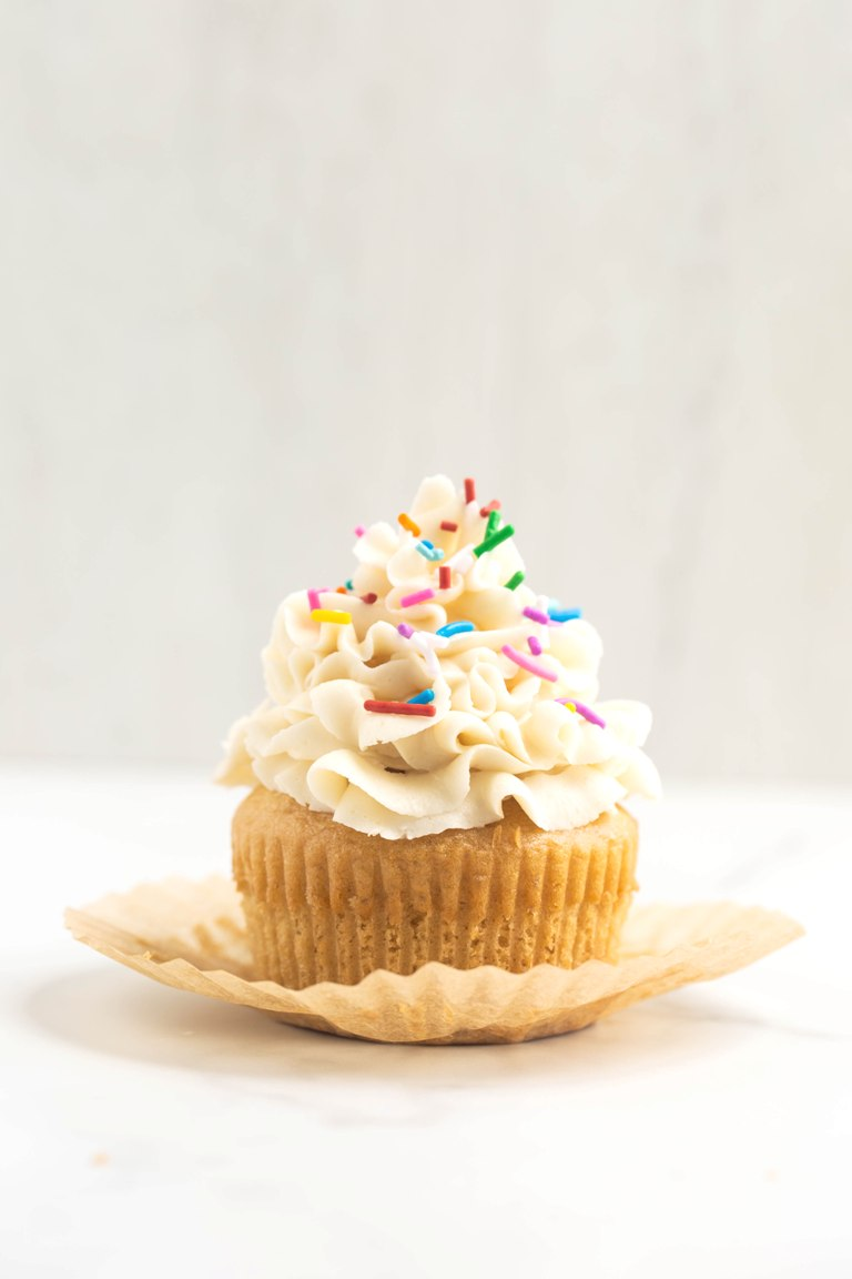 front view of cupcake with vanilla buttercream on top