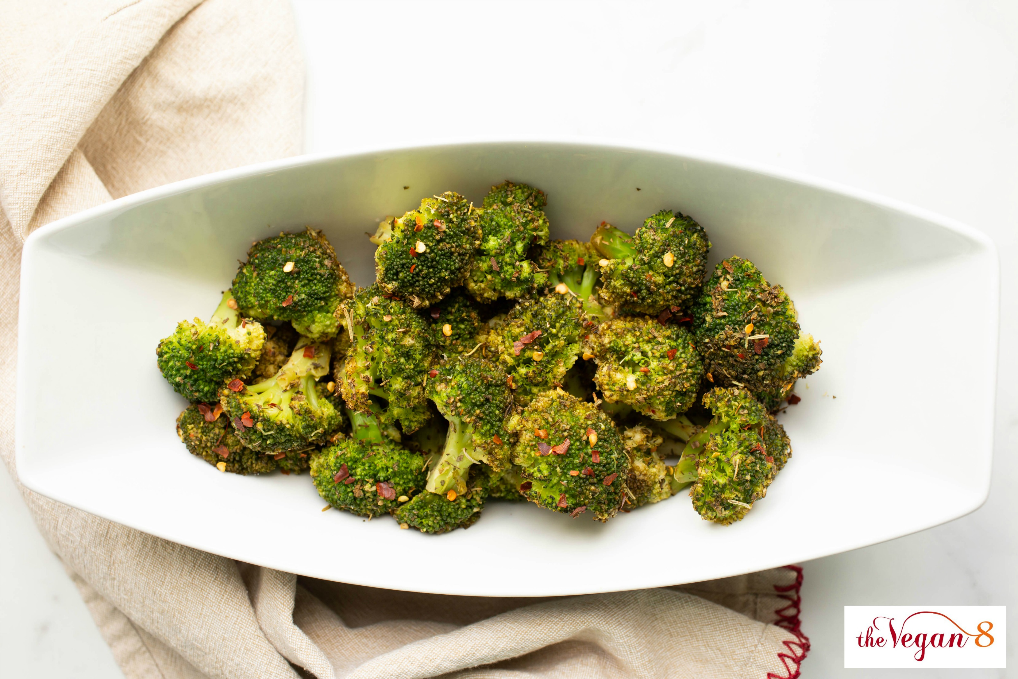 roasted broccoli with Italian spices in white bowl