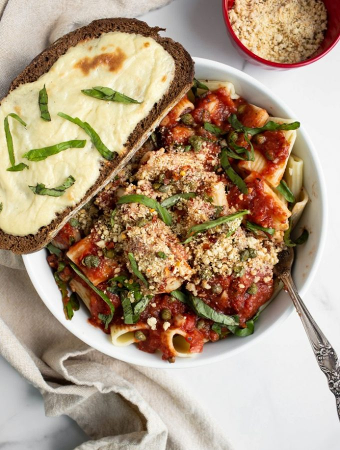 tomato garlic sauce over rigatoni and fresh basil