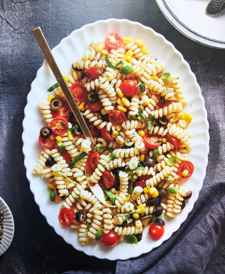 pasta with olives tomatoes corn and basil