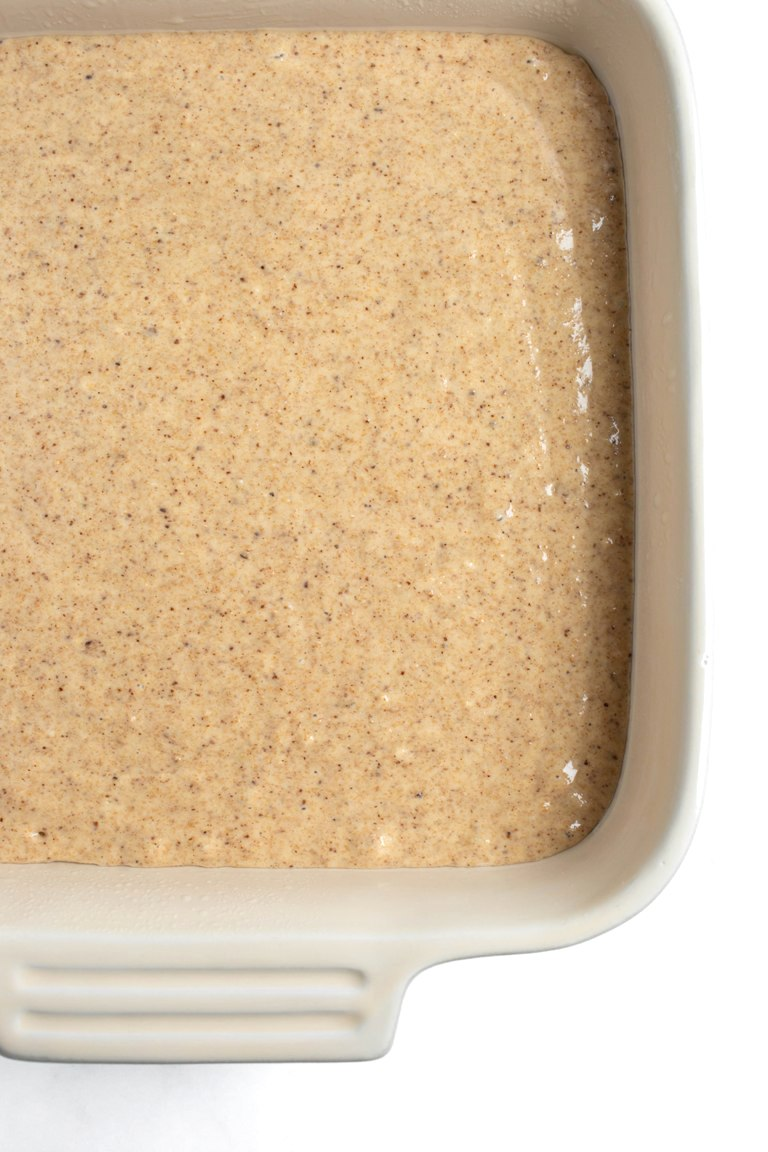 almond butter cake batter in square dish