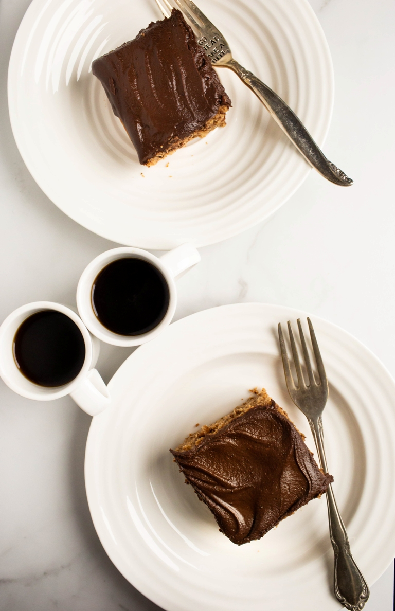 2 white plates with cake and 2 cups of coffee
