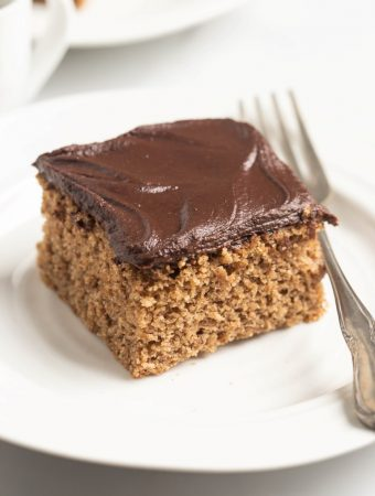 square slice of almond butter cake with fork