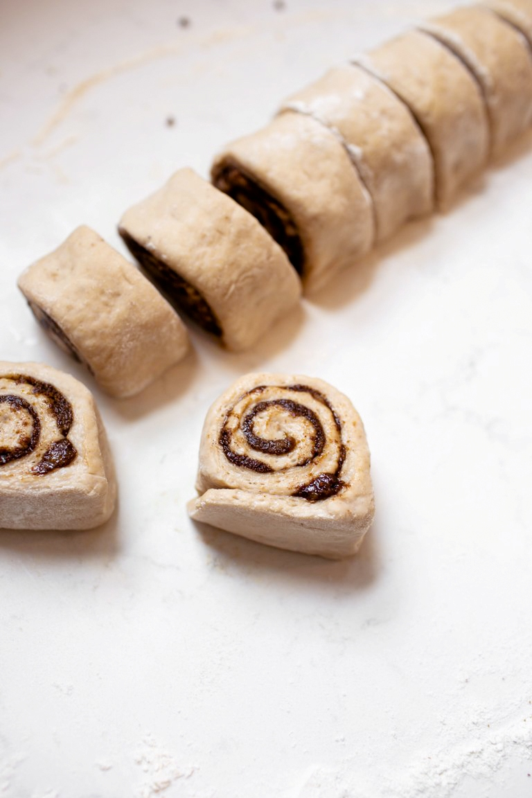 log of sliced cinnamon rolls before baking