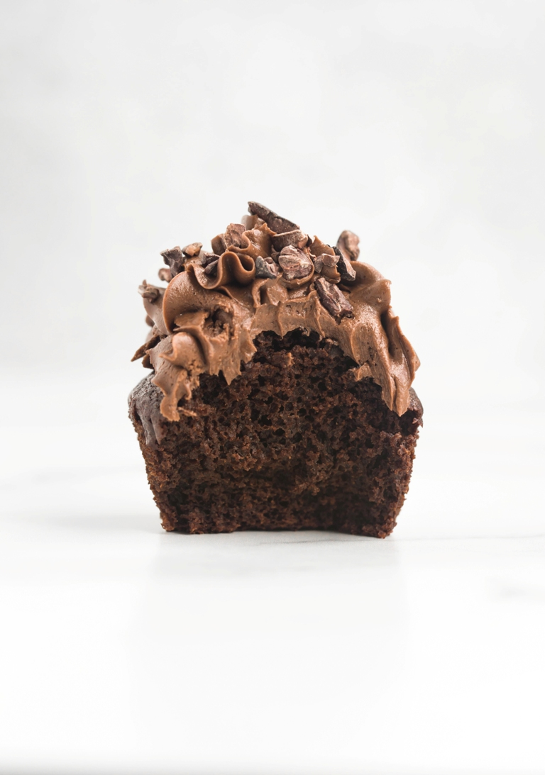 inside view of cupcake with chocolate frosting