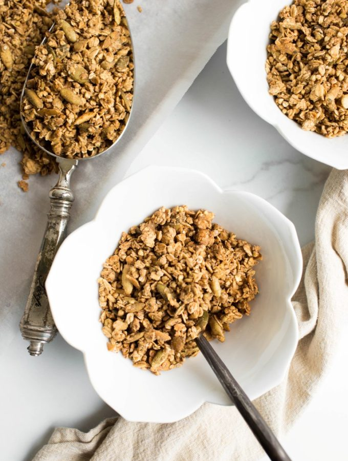 2 white bowls with buckwheat granola