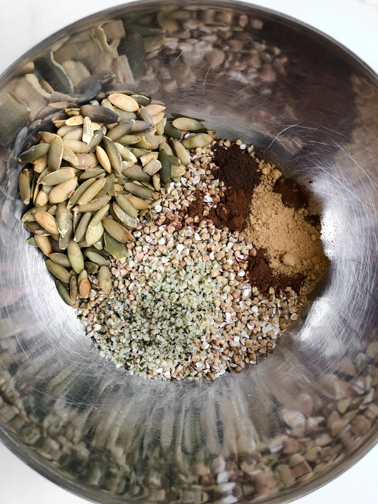 ingredients in silver bowl for buckwheat granola