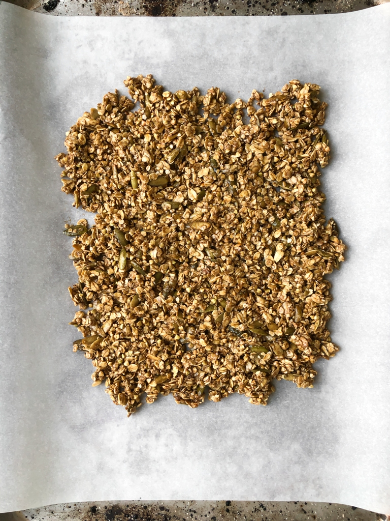 spread out granola mixture on pan before baking