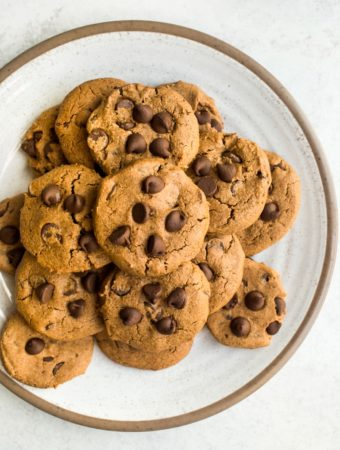 large white plate of vegan pumpkin chocolate chip cookies