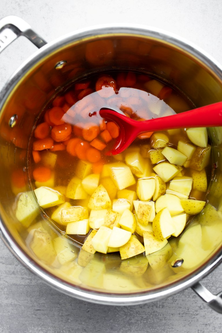 potatoes and carrots in pot of water
